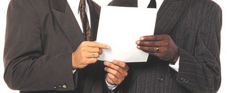 hands holding business memo