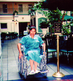 housekeeper in wheelchair